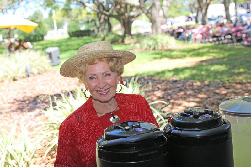 Elderly Woman in Red Wearing a Hat