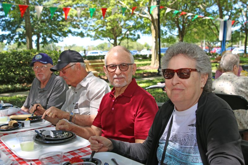 Four Elderly People Eating Lunch Outside