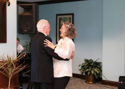 Elderly Man and Elderly Woman Dancing at Mease Life Retirement Home
