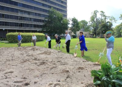Seven People Holding Shovels and Digging at Mease Life Retirement Home