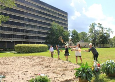 Five People Holding Shovels and Digging at Mease Life Retirement Home