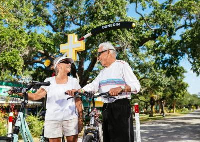 Two Seniors Riding Bikes Outdoors