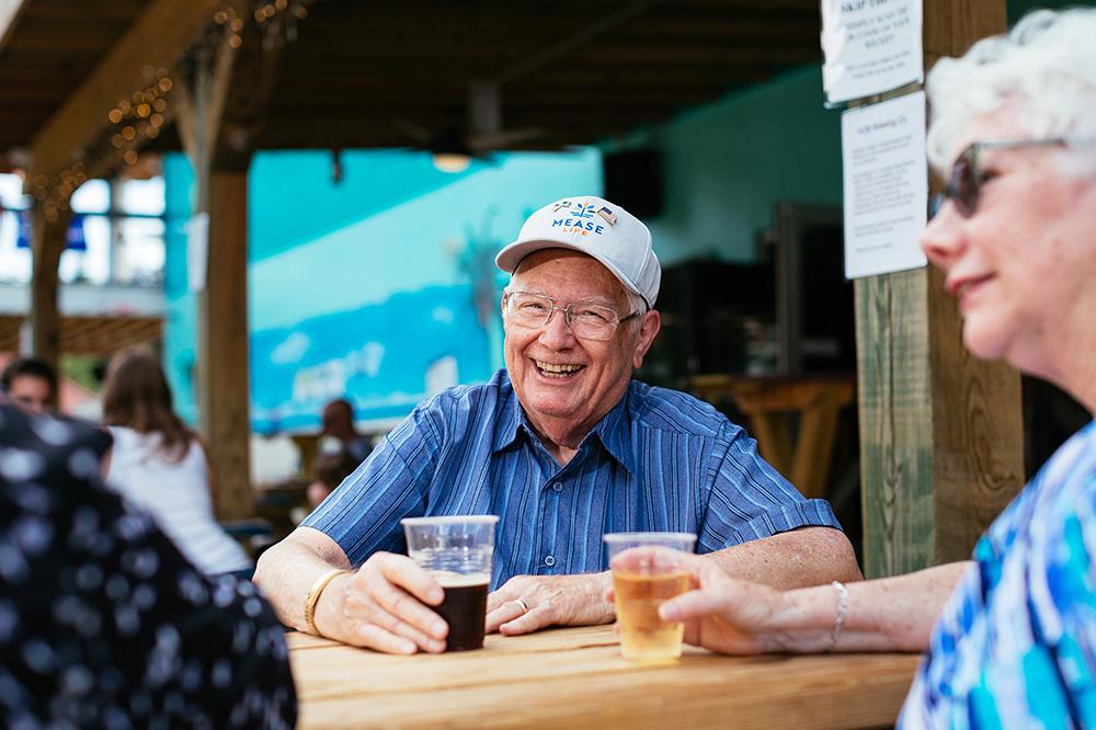 Two Seniors Enjoying Beverages Outdoors