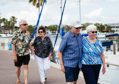 Four Seniors Taking a Walk by the Water