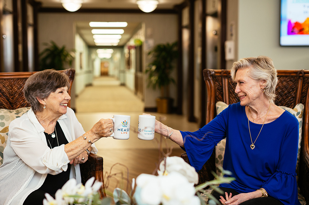 Two Seniors Enjoying a Cup of Coffee at Mease Life