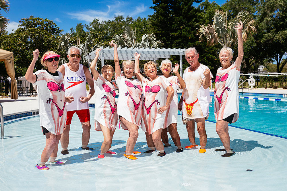 Group of Seniors Posing for a Photo by the Pool at Mease Life