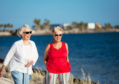 Two Elderly Women Walking Along the Water at Mease Life