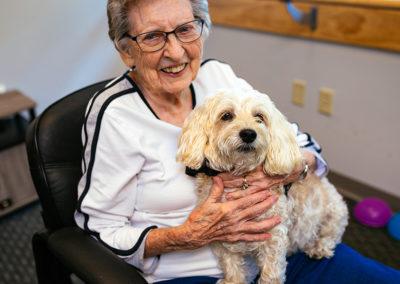 Elderly Woman Holding a Dog