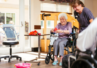 Elderly Woman in a Wheel Chair Exercising